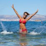 Bikini model splashing water — Stock Photo #50685977