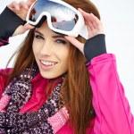 Caucasian woman wearing ski goggles — Stock Photo #50685993