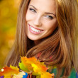 Woman in a park in autumn — Stock Photo #50686061