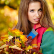 Woman in a park in autumn — Stock Photo #50686073