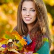 Woman in a park in autumn — Stock Photo #50686077