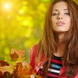 Woman in a park in autumn — Stock Photo #50686091