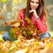 Woman in a park in autumn — Stock Photo #50686109