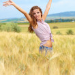 Woman in a wheat field — Stock Photo #50686127