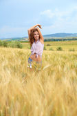 Woman in a wheat field — Stock Photo
