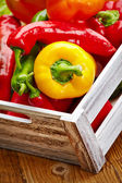 Peppers in a wooden box — Stock Photo