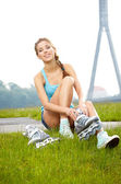 Woman skating with rollerblades — Stock Photo