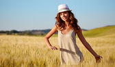 Woman on golden cereal field — Stock Photo