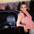 Beautiful woman on black cabriolet — Stock Photo #6658493