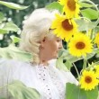 Woman in sunflowers — Stockvideo