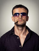 Man in sunglasses with a cigar — Stock Photo