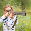 A young girl with a gun for trap shooting — Stock Photo #13404014