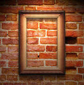 The wood frame on brown brick wall — Stock Photo