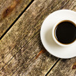 Cup of Coffee on a wood — Stock Photo