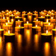 Stock Photo: Panorama of the many burning candles