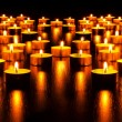 Panorama of the many burning candles — Stock Photo