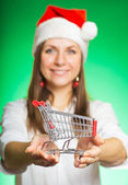 Cheerful girl in a Christmas hat — Stock Photo