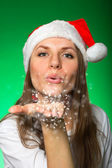 Girl in a Christmas hat and snowflakes — Stok fotoğraf