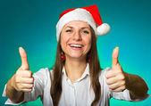 Girl in a Christmas hat — Stok fotoğraf