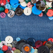 Stock Photo: Buttons with blue jeans copy space
