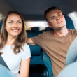 Young couple in a car — Stock Photo #23294988