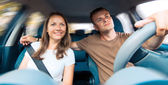 Young couple in a car — Stock Photo