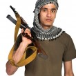 Terrorist with automatic gun and  on white background - Stock Photo