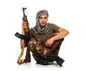 Terrorista com arma automática no fundo branco — Fotografia Stock
