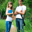 Two students studying in park — Stock Photo
