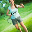 Smiling girl with a racket for a badminton in the park - Lizenzfreies Foto