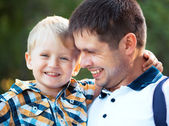 Happy father and his baby son having fun in the park — Stock Photo
