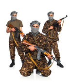 Arabs with automatic gun on white background — Stock Photo