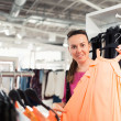 Woman in a clothing store — Stock Photo