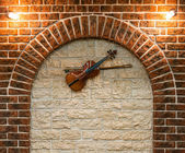 Element of the interior with a violin — Stock Photo