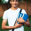 Arab male student with books outdoors — Foto de Stock