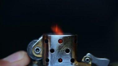 Hand lighting retro lighter — Stock Video