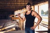 Muscular man with baseball bat — Stock Photo