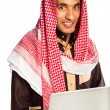 Young smiling arab with laptop isolated on white — Stock Photo