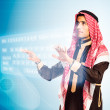 Arab man pressing virtual keybord — Stock Photo