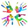 Handprints in different colors on a white — Stock Photo