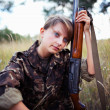 Stock Photo: Young girl with shotgun in outdoor