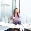 Happy businesswoman talking on the cellphone in a cafe — Stock Photo