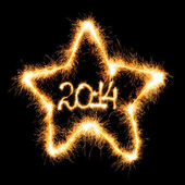 Happy New Year - 2014 in star made a sparkler — Stock Photo
