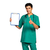 Portrait of doctor Arab nationality with health record on white — Stock Photo
