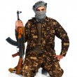 Stock Photo: Arab nationality in camouflage suit and keffiyeh with automatic