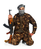 Arab nationality in camouflage suit and keffiyeh with automatic — Stock Photo
