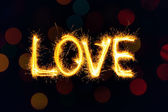 Valentines Day - Love made a sparkler on black — Stock Photo