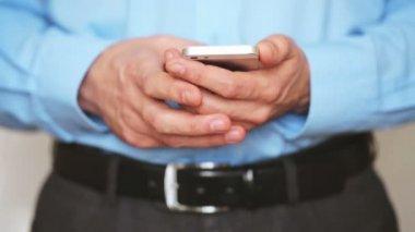 Businessman using smartphone — Stock Video