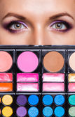 Closeup of beautiful womanish eyes with makeup kit — Stock Photo