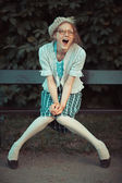 Funny girl with glasses and a vintage dress — ストック写真